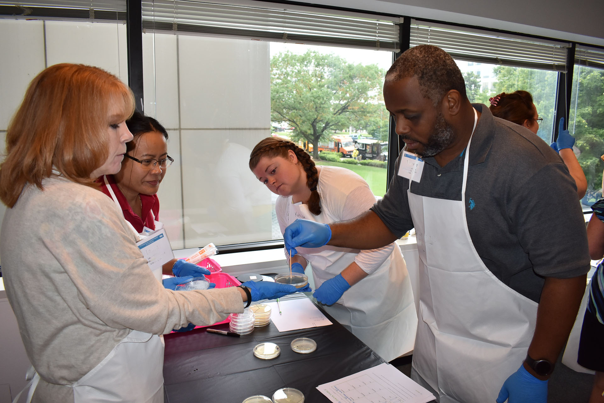 Teachers participating in a lab